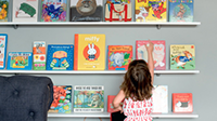 child at book shelf